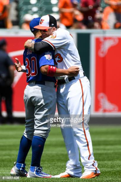 Baltimore Orioles third baseman Manny Machado and Chicago Cubs left fielder Jon Jay embrace pior to the start of an MLB game between the Chicago Cubs...