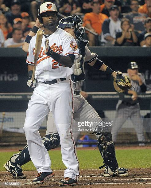 Baltimore Orioles' Wilson Betemit reacts after striking out against New York Yankees starting pitcher Phil Hughes during the sixth inning at Oriole...