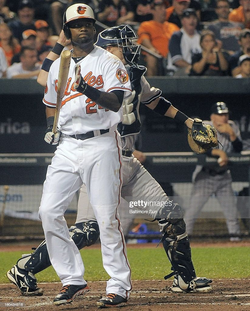 Baltimore Orioles' Wilson Betemit (24) reacts after striking out against New York Yankees starting pitcher David Huff during the sixth inning at Oriole Park at Camden Yards in Baltimore, Maryland, Thursday, September 12, 2013.