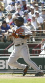 Baltimore Orioless shortstop Miguel Tejada shatters his bat as he is thrown out at first base in the fifth inning of the 76 win over the Texas...