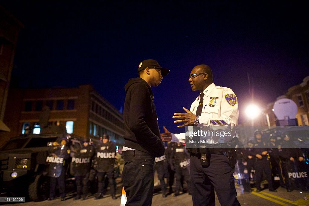 Baltimore police captain tries to calm a protester the night after citywide riots over the death of Freddie Gray on April 28 2015 in Baltimore...