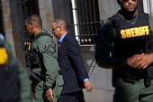 Baltimore police officer Caesar Goodson Jr exits the Circuit Court on the first day in the trial on June 9 2016 in Baltimore Maryland Officer Goodson...