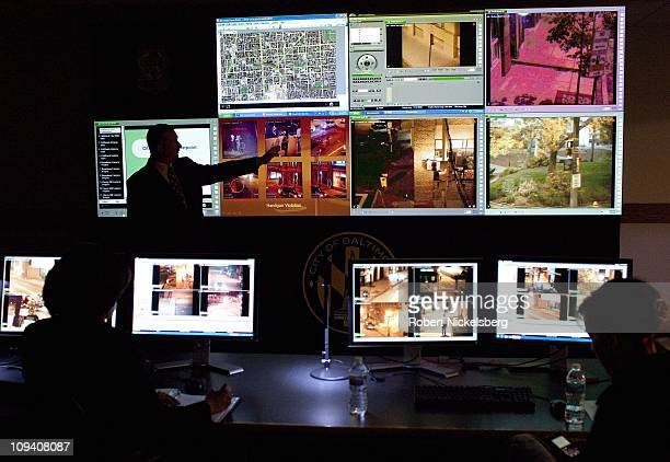 Baltimore Police officer describes how the closed circuit television screens monitors high crime locations for Mayor Stephanie RawlingsBlake left at...