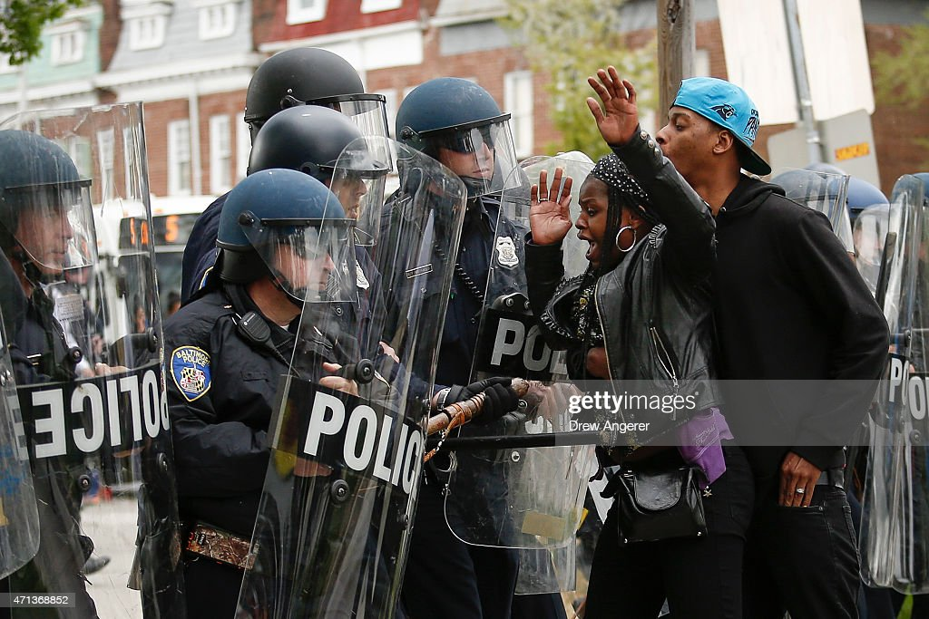 Baltimore Police officers in riot gear push protestors back along Reisterstown Road near Mondawmin Mall April 27 2015 in Baltimore Maryland A group...