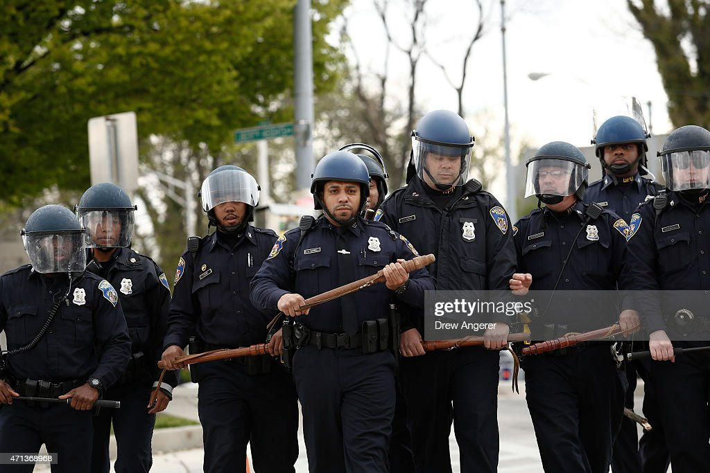 Baltimore Police officers in riot gear walk toward protestors along Reisterstown Road near Mondawmin Mall April 27 2015 in Baltimore Maryland A group...