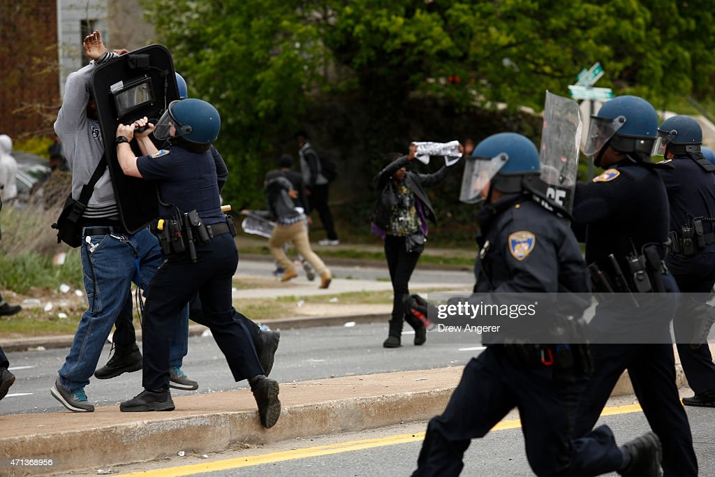 Baltimore Police officers push back a protester on Reisterstown Road near Mowdamin Mall April 27 2015 in Baltimore Maryland The funeral service for...