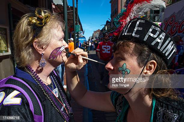 Baltimore Raven fan gets her face painted outside the stadium before Super Bowl XLVII between the Baltimore Ravens and the San Francisco 49ers on...