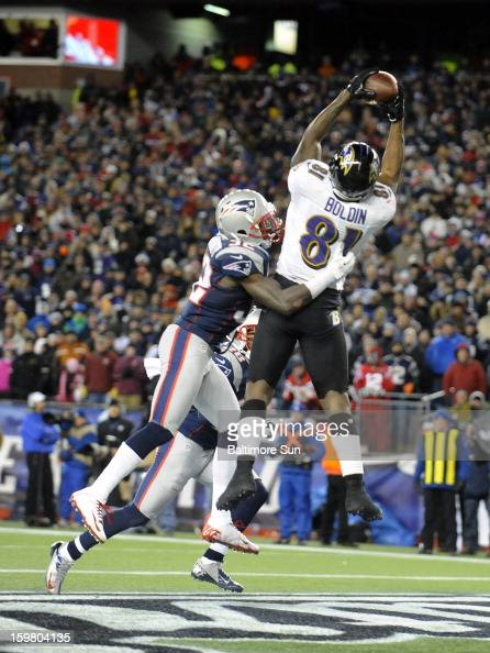 Baltimore Ravens' Anquan Boldin catches a touchdown pass in front of New England Patriots' Devin McCourty left in the fourth quarter of the AFC...