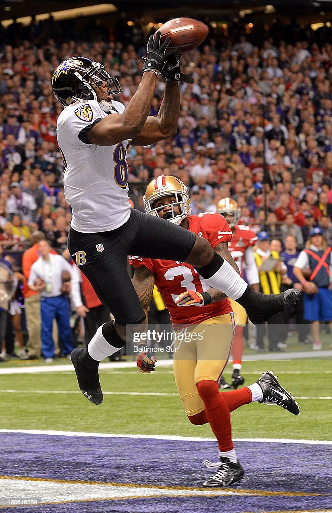 Baltimore Ravens' Anquan Boldin (81) hauls in a touchdown pass against the San Francisco 49ers during first-quarter action in Super Bowl XLVII at the Mercedes-Benz Superdome in New Orleans, Louisiana, Sunday, February 3, 2013.