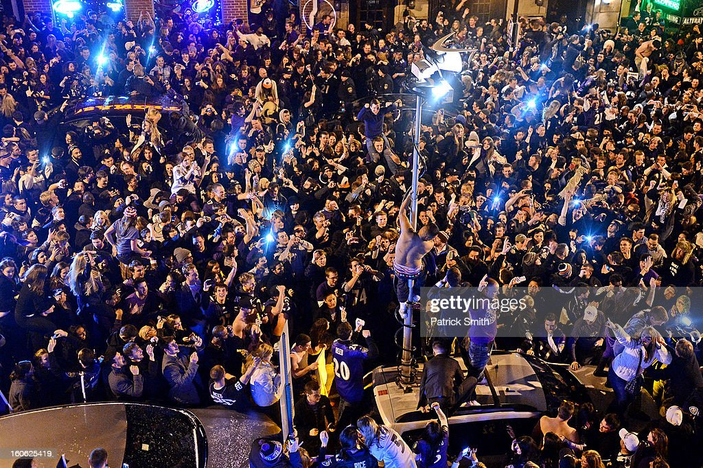 Baltimore Ravens celebrate in the streets after Super Bowl XLVII against the San Francisco 49ers in the neighborhood of Federal Hill on February 3, 2013 in Baltimore, Maryland. The Baltimore Ravens won the Super Bowl, 34-31, to capture their second championship title.
