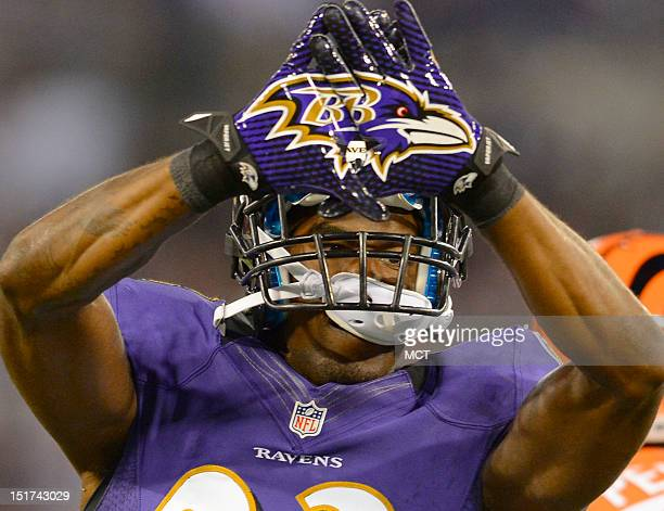 Baltimore Ravens' Chykie Brown puts his hands together to form the Ravens logo after making a special teams tackle during the first half as the...