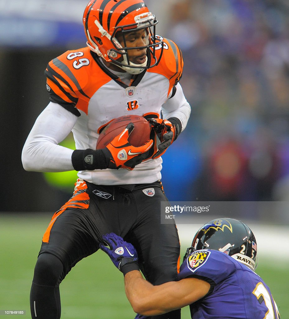 Baltimore Ravens cornerback Chris Carr makes the stop of Cincinnati Bengals wide receiver Jerome Simpson just before the receiver fumbles during second half. The Ravens defeat Cincinnati 13-7 on Sunday, January 2, 2011, at M&T Bank Stadium in Baltimore, Maryland.