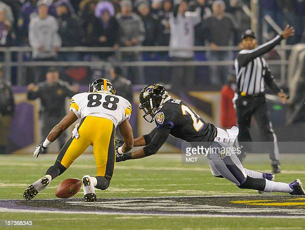 Baltimore Ravens cornerback Corey Graham and Pittsburgh Steelers wide receiver Emmanuel Sanders dive for a loose ball after Sanders looses the handle...