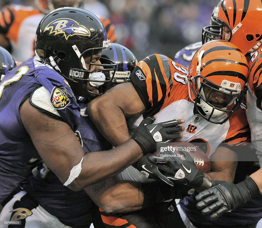 Baltimore Ravens' Cory Reading and teammates stop Cincinnati Bengals' Cedric Benson short of a first down in the 4th quarter. The Ravens defeated the Bengals, 13-7, on Sunday, January 2, 2011, at M&T Bank Stadium in Baltimore, Maryland.