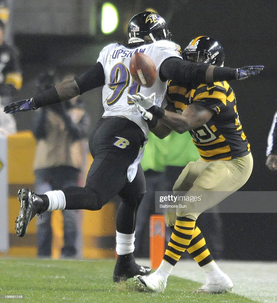 Baltimore Ravens' Courtney Upshaw stops Pittsburgh Steelers' Will Johnson from catching a fourth-quarter pass at Heinz Field on Sunday, November 18, 2012, in Pittsburgh, Pennsylvania.