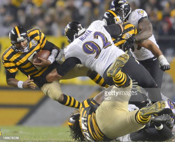 Baltimore Ravens defensive end DeAngelo Tyson beats his blockers to record a sack of Pittsburgh Steelers quarterback Byron Leftwich in the second...