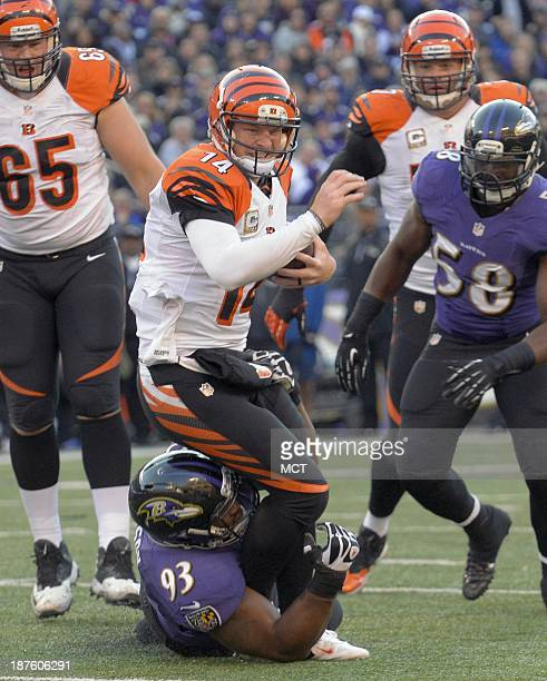 Baltimore Ravens defensive end DeAngelo Tyson takes down Cincinnati Bengals quarterback Andy Dalton as he attempts to scramble during the second half...