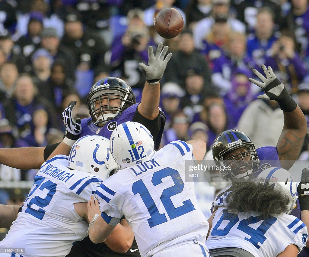 Baltimore Ravens defensive end Haloti Ngata gets a hand up to disrupt the pass of Indianapolis Colts quarterback Andrew Luck during the second half of their AFC playoff game in Baltimore, Maryland, on Sunday, January 6, 2013.