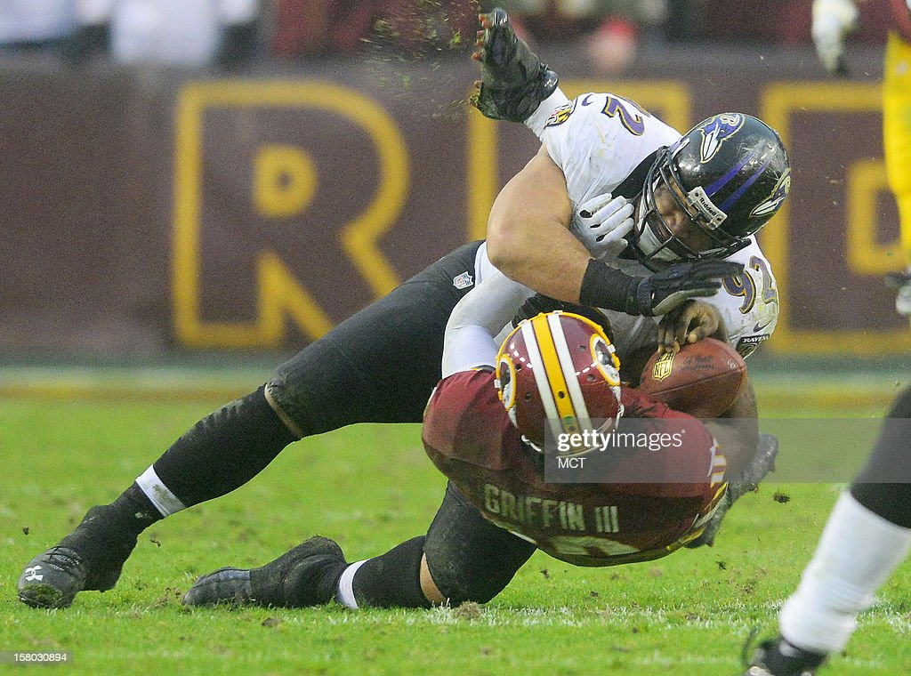 Baltimore Ravens defensive end Haloti Ngata lays a hit on Washington Redskins quarterback Robert Griffin III that takes him out of the game during the second half in Landover, Maryland, on Sunday, December 9, 2012. Washington takes a 31-28 win over Baltimore in overtime.