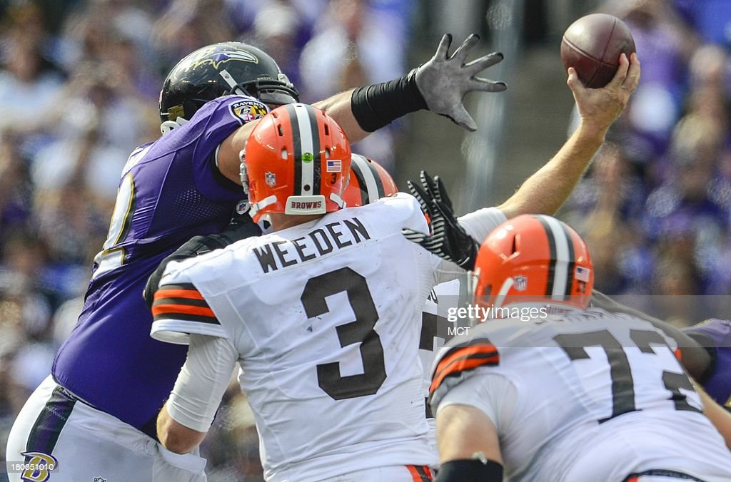 Baltimore Ravens defensive tackle Haloti Ngata gets his hand in the face of Cleveland Browns quarterback Brandon Weeden during the second half of their game on Sunday, September 15, 2013, in Baltimore, Maryland.