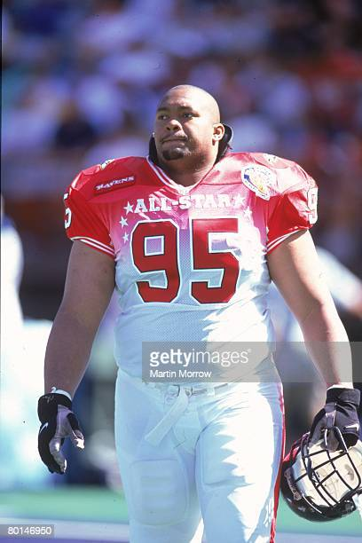 Baltimore Ravens defensive tackle Sam Adams of the AFC walks off the field against the NFC in the 2001 NFL Pro Bowl at Aloha Stadium on February 4...