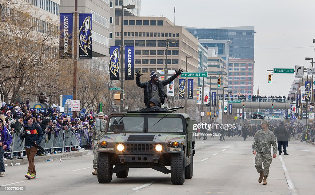 Baltimore Ravens Ed Reed, center, waves to fans during a parade in Baltimore, Maryland, Tuesday, February 5, 2013.