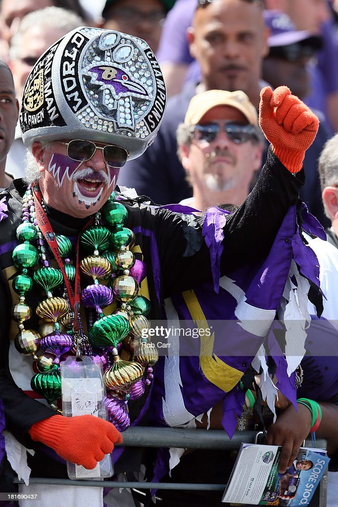 A Baltimore Ravens fan cheers during the team introductions before the start of the Ravens and Cleveland Browns game at M&T Bank Stadium on September 15, 2013 in Baltimore, Maryland.