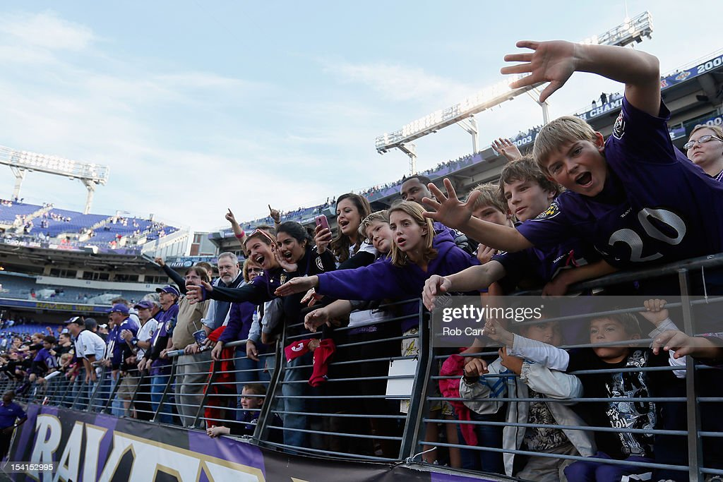 Baltimore Ravens fans cheer as the team leaves the field following the Ravens 31-29 win over the Dallas Cowboys at M&T Bank Stadium on October 14, 2012 in Baltimore, Maryland.