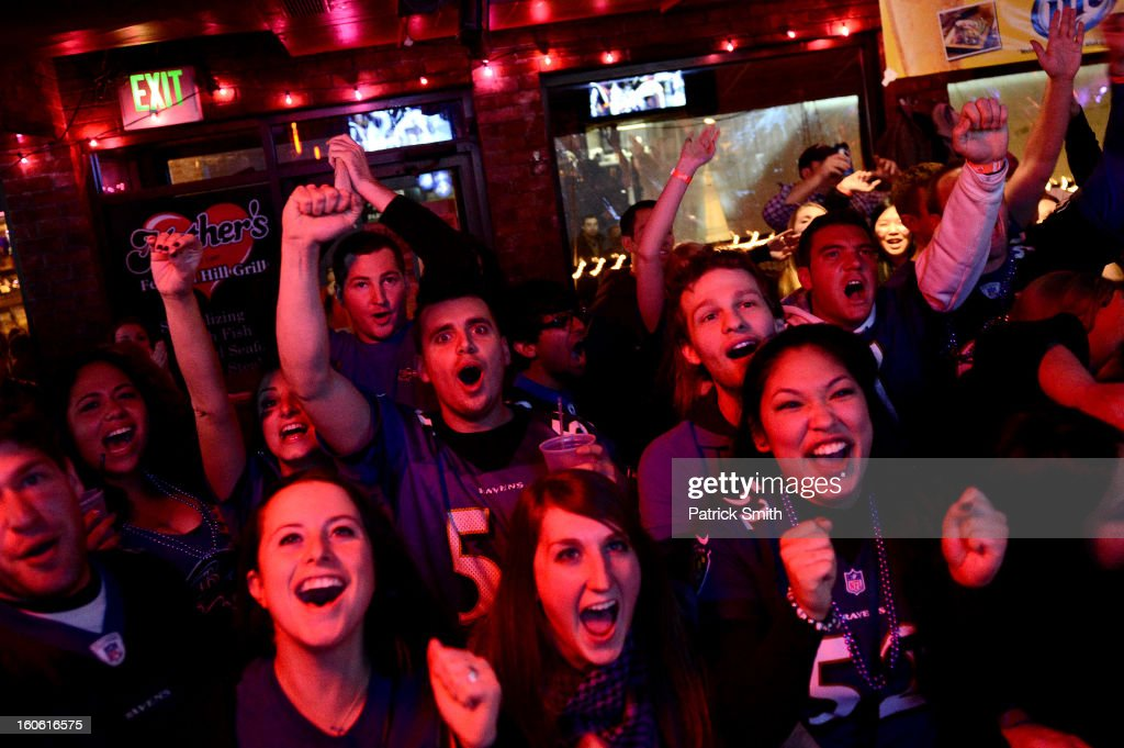 Baltimore Ravens fans cheer as they gather to watch Super Bowl XLVII against the San Francisco 49ers in the neighborhood of Federal Hill on February 3, 2013 in Baltimore, Maryland. The Baltimore Ravens are making their first Super Bowl appearance since they last won in 2000.