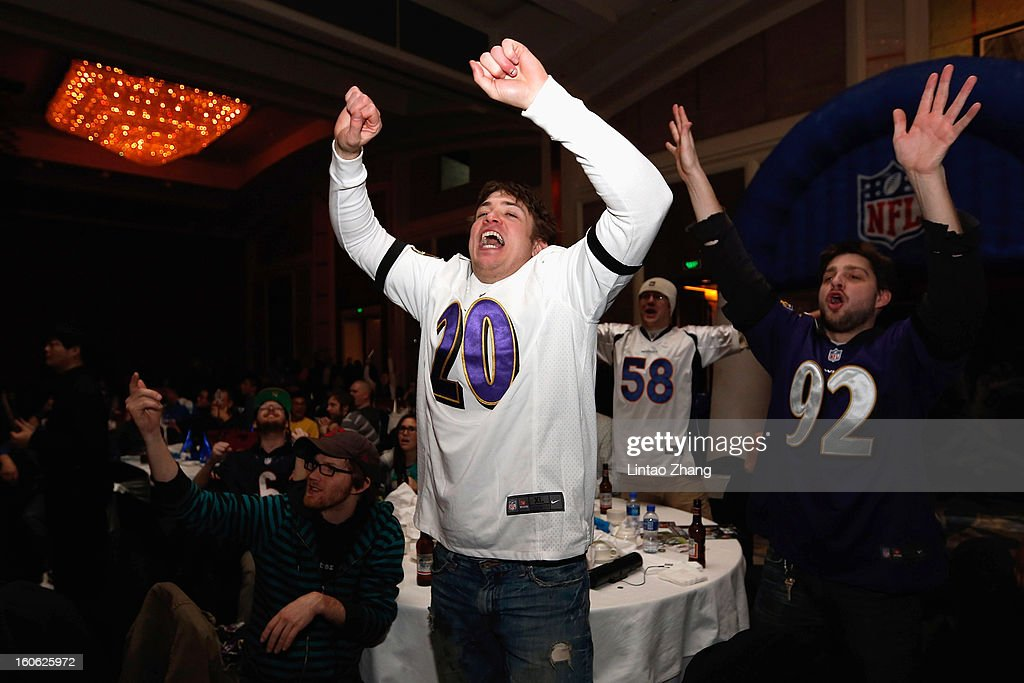 Baltimore Ravens fans cheer as they gather to watch Super Bowl XLVII against the San Francisco 49ers during the official NFL China Super Bowl Party at Kerry Hotel on February 4, 2013 in Beijing, China.