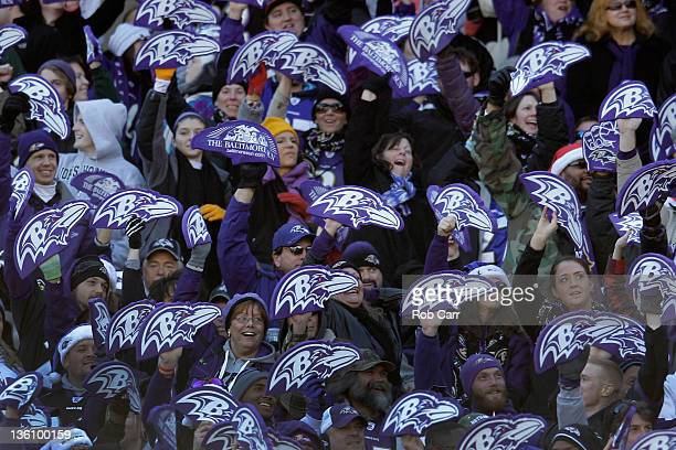 Baltimore Ravens fans hold up foam logos during the second half against the Cleveland Browns at MT Bank Stadium on December 24 2011 in Baltimore...