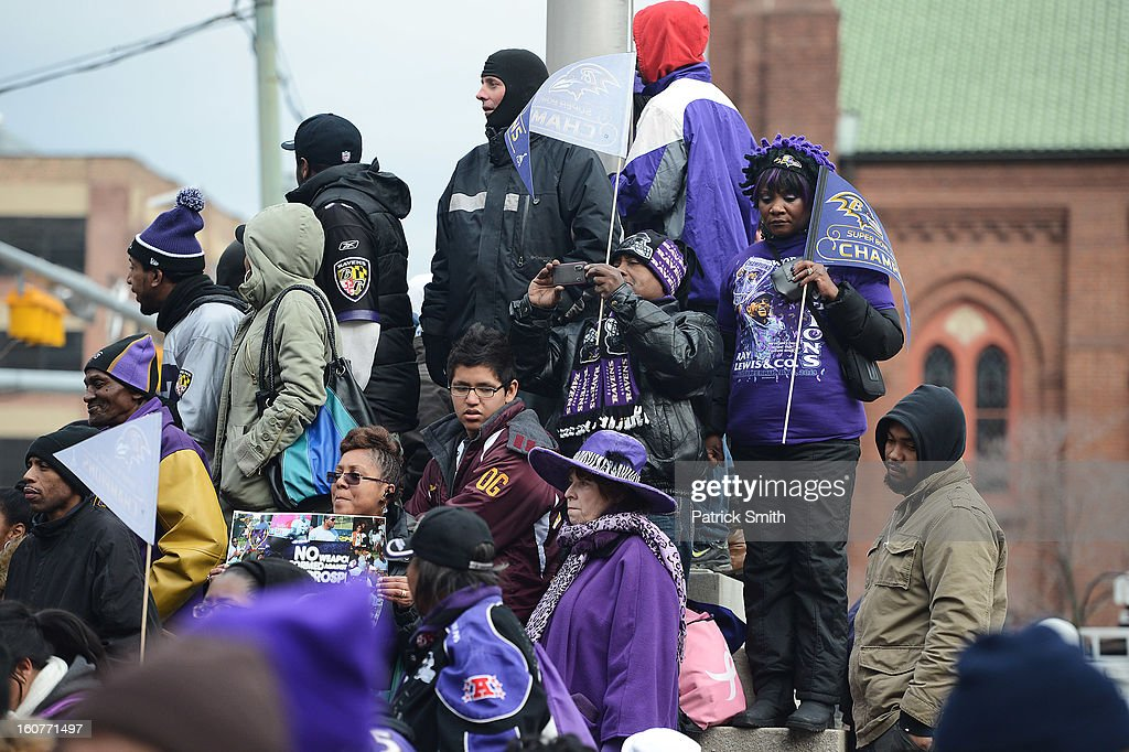Baltimore Ravens fans take pictures as players pass during their Super Bowl XLVII victory parade near M&T Bank Stadium on February 5, 2013 in Baltimore, Maryland. The Baltimore Ravens captured their second Super Bowl title by defeating the San Francisco 49ers.