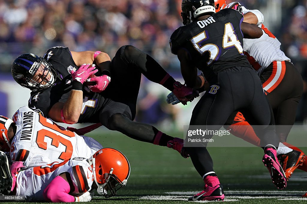 Baltimore Ravens fullback Kyle Juszczyk #44 is tackled by Cleveland Browns defensive back K'Waun Williams #36 in the second half at M&T Bank Stadium on October 11, 2015 in Baltimore, Maryland. The Cleveland Browns won, 33-30.