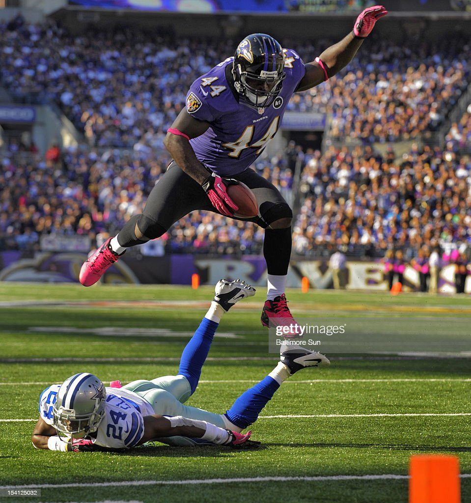 Baltimore Ravens fullback Vonta Leach leaps over Dallas Cowboys cornerback Morris Claiborne in the red zone to help set up a touchdown in the fourth...