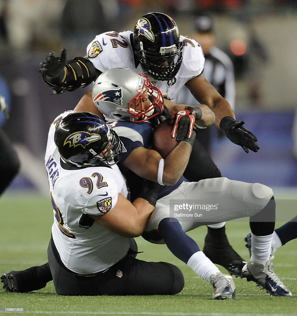 Baltimore Ravens Haloti Ngata and Ray Lewis stop New England Patriots Shane Vereen for no gain during the first quarter in the AFC Championship game at Gillette Stadium on Sunday, January 20, 2013, in Foxboro, Massachusetts.
