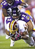 Baltimore Ravens Haloti Ngata tackles Washington Redskins Ladell Betts during the Washington Redskins vs Baltimore Ravens game at FedEx Field August...