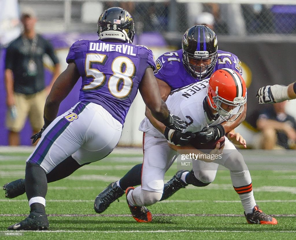 Baltimore Ravens inside linebacker Daryl Smith records a sack on Cleveland Browns quarterback Brandon Weeden as teammate Elvis Dumervil lends an assist during the second half of their game on Sunday, September 15, 2013, in Baltimore, Maryland.