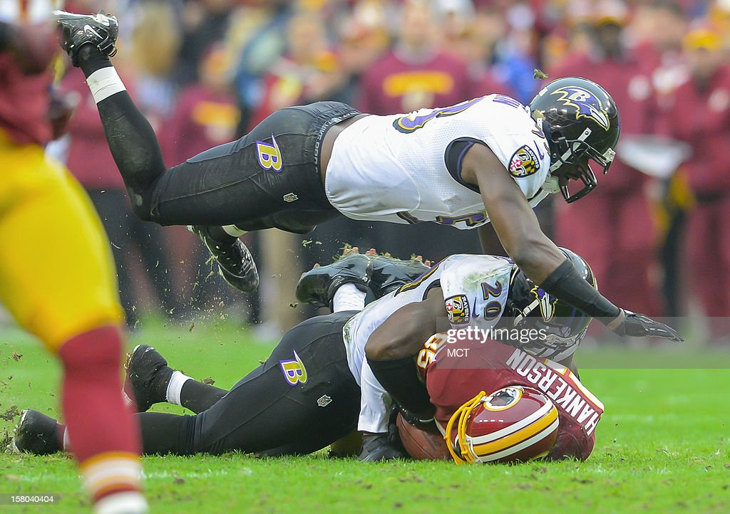 Baltimore Ravens inside linebacker Jameel McClain goes airborne to help teammate, Ed Reed, bring down Washington Redskins wide receiver Leonard Hankerson following a reception during the first half of their game in Landover, Maryland, on Sunday, December 9, 2012. Washington takes a 31-28 win over Baltimore in overtime.