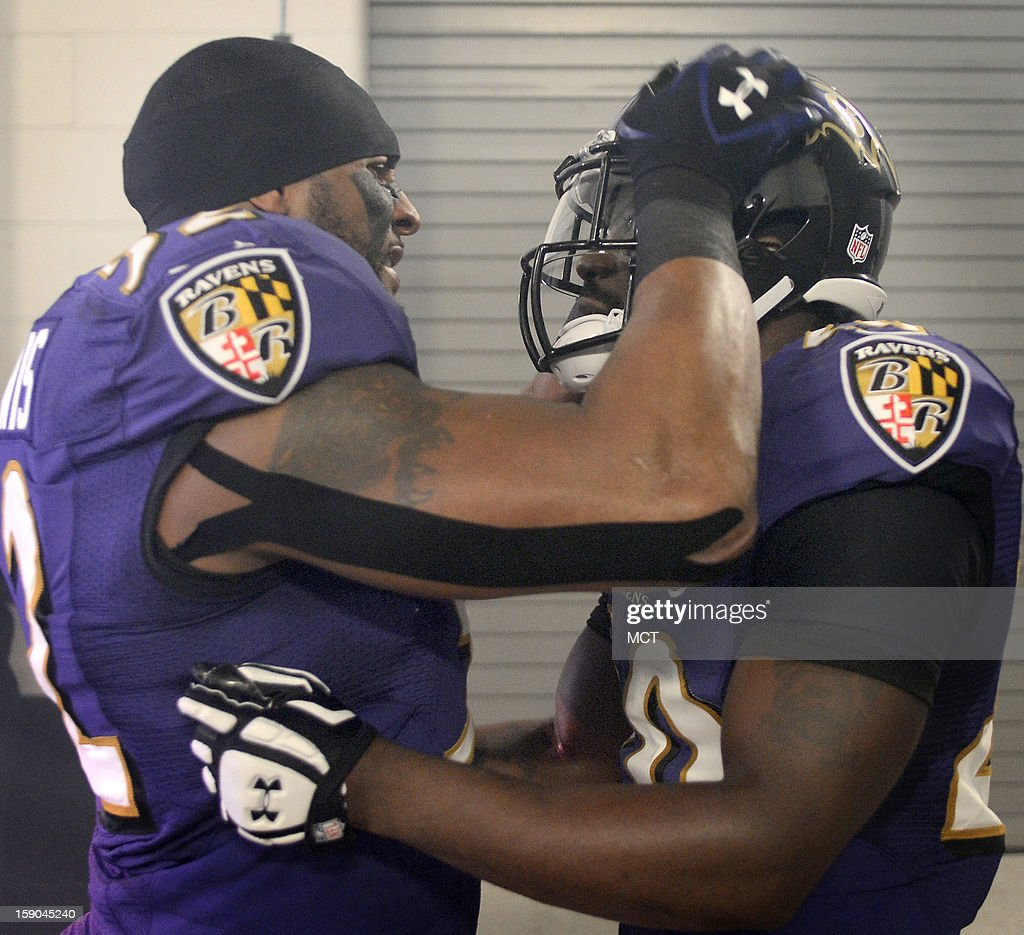Baltimore Ravens inside linebacker Ray Lewis embraces and talks with longtime teammate Ed Reed in the tunnel before pre game introductions at AFC playoff game in Baltimore, Maryland, on Sunday, January 6, 2013.