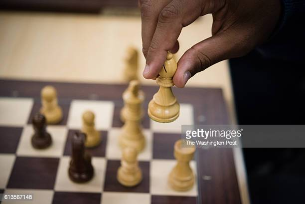 Baltimore Ravens left guard John Urschel plays chess with members of the award winning University of Maryland Baltimore County chess team He moves a...