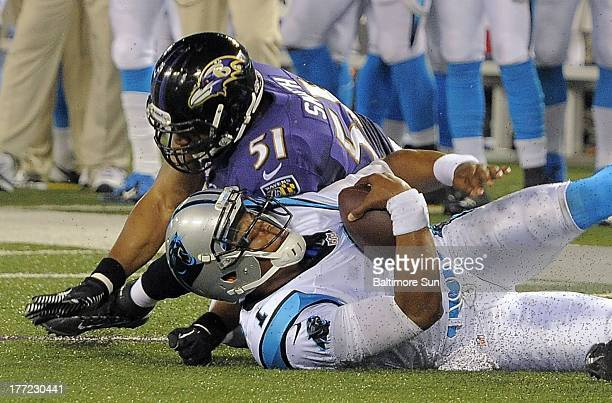 ... Baltimore Ravens linebacker Daryl Smith makes a late hit on Carolina  Panthers quarterback Cam Newton drawing ... f43241489