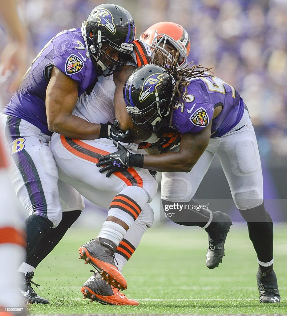 Baltimore Ravens linebackers Daryl Smith (L) and Josh Bynes sandwich Cleveland Browns Trent Richardson during the second half of their game on Sunday, September 15, 2013, in Baltimore, Maryland.