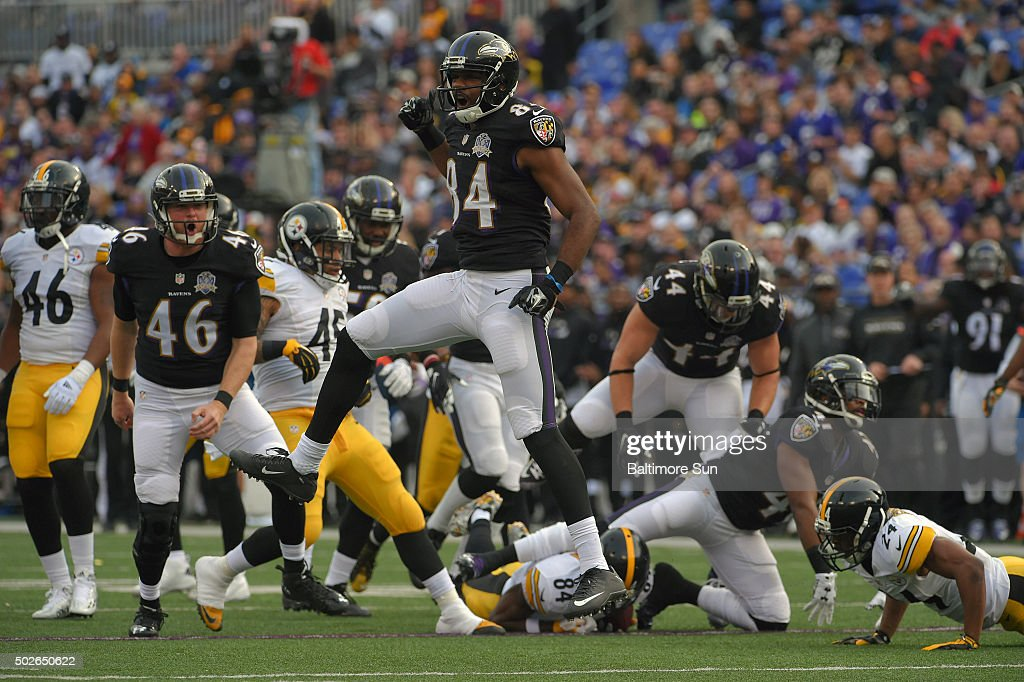 Baltimore Ravens' Morgan Cox reacts with Chris Matthews after stopping Pittsburgh Steelers' Antonio Brown on special teams during the third quarter...