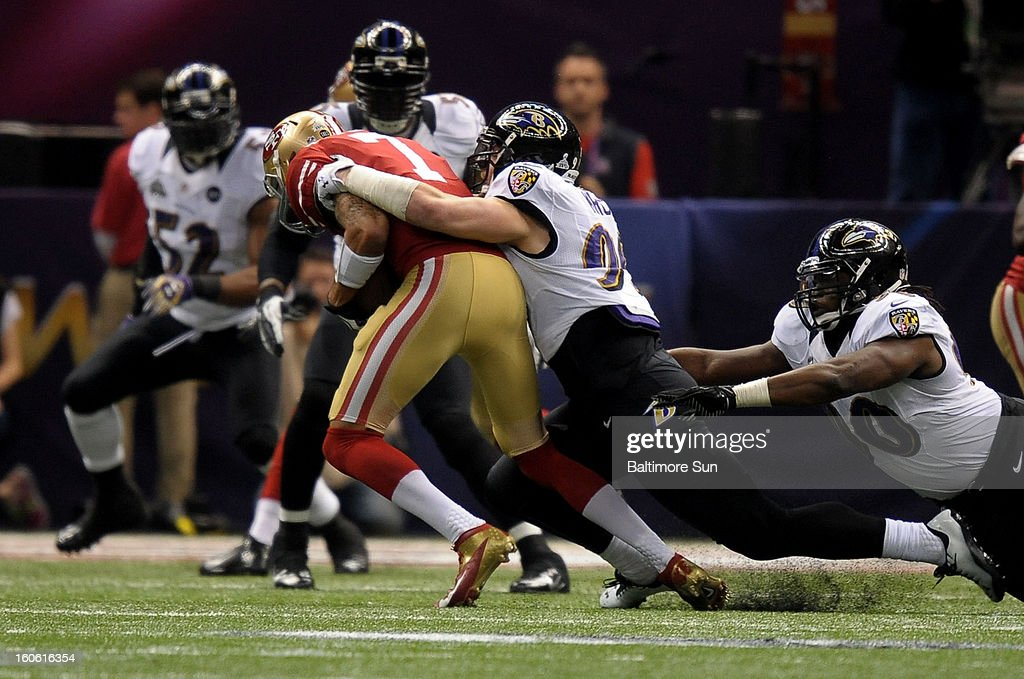 Baltimore Ravens' Paul Kruger sacks San Francisco 49ers quarterback Colin Kaepernick (7) during first-quarter action in Super Bowl XLVII at the Mercedes-Benz Superdome in New Orleans, Louisiana, Sunday, February 3, 2013.