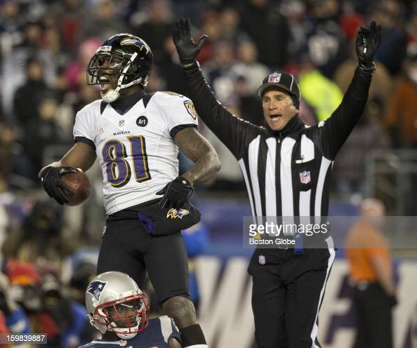 Baltimore Ravens player Anquan Boldin celebrates his touchdown reception beating New England Patriots player Devin McCourty during fourth quarter...