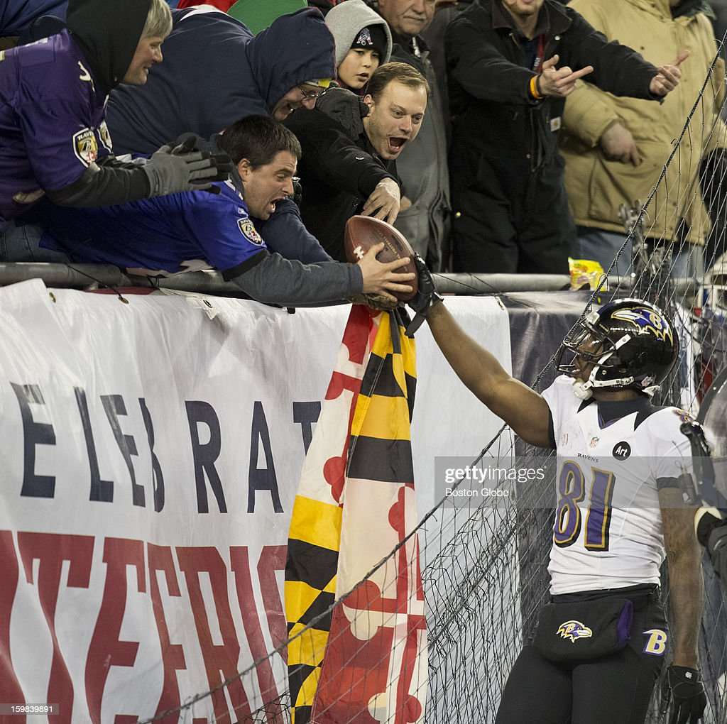 Baltimore Ravens player Anquan Boldin gives a Ravens fan the football after his second touchdown reception of the quarter against the New England Patriots during fourth quarter action of the AFC Championship Game at Gillette Stadium on Sunday, Jan. 20, 2013.