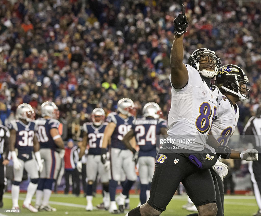 Baltimore Ravens player Anquan Boldin runs off the field pointing towards the sky after his second touchdown reception of the fourth quarter against the New England Patriots during the AFC Championship Game at Gillette Stadium on Sunday, Jan. 20, 2013.