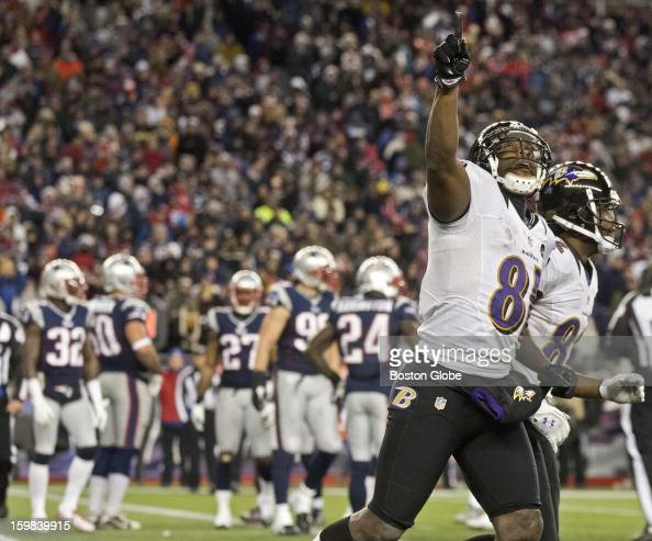 Baltimore Ravens player Anquan Boldin runs off the field pointing towards the sky after his second touchdown reception of the fourth quarter against...
