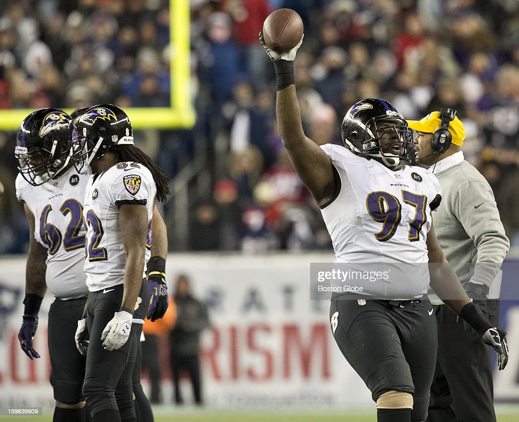 Baltimore Ravens player Arthur Jones holds up the ball after recovering New England Patriots player Stevan Ridley's fumble during fourth quarter action of the AFC Championship Game at Gillette Stadium on Sunday, Jan. 20, 2013.