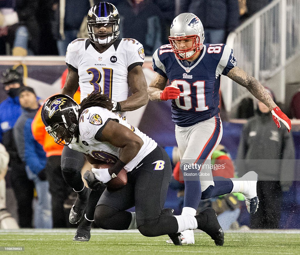 Baltimore Ravens player Dannell Ellerbe intercepts the ball in front of New England Patriots player Aaron Hernandez during fourth quarter action of the AFC Championship Game at Gillette Stadium on Sunday, Jan. 20, 2013.